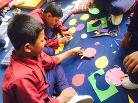 Children involved in creative art and craft at transit home