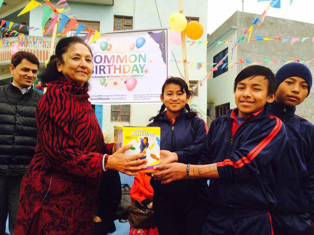 Prize distibution by executive member on common birthday
